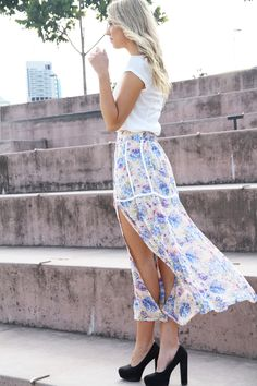 soft, floral skirt paired with bold, solid shoes