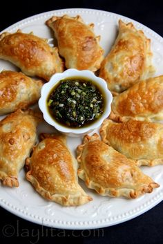 Empanadas filled with asparagus, fava beans, peas and goat cheese - served with balsamic chimichurri