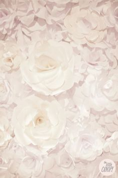 Artsy Chanel inspired Handmade Paper Flower Wedding Backdrop  **This site is a resource for so many types of paper flower tutorials.  This canopy is beautiful.