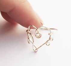 it's a heart ring made out of a treble clef and bass clef.