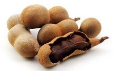 Tamarind - a brown sticky fruit inside a hard outer case. In western cuisine it is used in Worcestershire and HP sauce. In Grenada and the Grenadines, once it is ripened it is used in snacks, drinks, jellies, jams, juices, chutneys, and ice-creams.