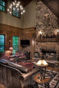 A mountain lodge retreat in your living room... I love this look by Lands End Development, Crosslake, MN