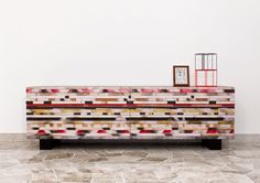 Soninke is recycled wood buffet by Davide G. Aquini that's inspired by African tribal art and patterns