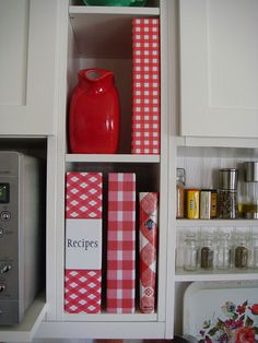 wrap recipe binders and books in coordinating paper to look pretty on the kitchen shelf ;)