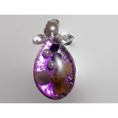 Unique Beautiful Angel Resin Christmas Ornament Pear Shaped Resin with... ($17) ❤ liked on Polyvore featuring home, home decor, holiday decorations, flower stem, glitter christmas ornaments, angel christmas tree ornaments, purple christmas tree ornaments and purple home accessories