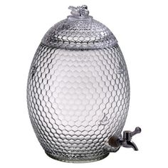 Glass beverage dispenser with beveled honeycomb detail and bee shaped topper.   Product: Beverage dispenserConstruction ...