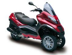 Piaggio MP3  - more info here: http://www.motorbikesgallery.com/review-of-the-piaggio-mp3.html