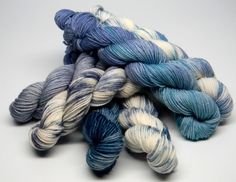 Blueberry Muffins - Set of Six Jig Monkey Mini Skeins - 20g/93 yards each - 120g/558 yards total    This yarn captures creamy white muffin batter dotted and smeared with juicy fresh picked blueberries in deep rich navy, teal, periwinkle, and sky blues all swirled together in a cohesive set.    Jig Monkey Yarn Base - 75% Superwash Merino/25% Nylon 20g/93 yards/mini skein  Soft, elastic and durable; a gorgeous sock yarn. Hand Wash ~ Air Dry    Want to add a little stripe to your project?…