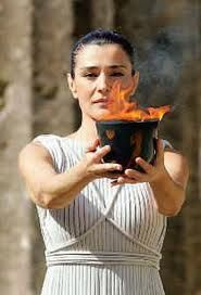 The High Priestess Maria Nafpliotou raises the Olympic flame during the Flame…