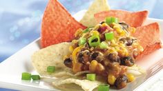 Guests will gobble up this delicious hot dip bursting with colourful corn, salsa and beans.