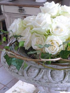 Beautiful white roses....looks like vintage to me   :0))