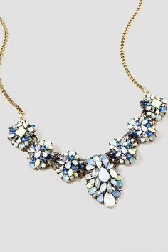 "Make a stunning statement wearing the Monahans Statement Necklace. Breathtaking, shimmering faceted jewels, clustered in floral representations and mounted on rhinestone brooches, make a beautiful drape across the neckline.<br />  <br />  - 15.5"" length<br />  - 3"" extension<br />  - Finished with spring ring clasp<br />  - Lead & nickel free<br />  - Imported<br />"