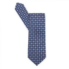 This men's Hugo Boss blue square pattern tie is made from 100% silk and looks great with a white or blue shirt.