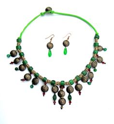 An oriental in style set of jewelry - necklace and earrings made of green glass with dark red beads