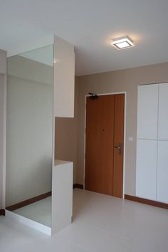 A shoe cabinet to partition the entrance walkway and the living/dining area