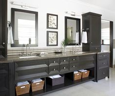 Smart vanity storage puts everything at your fingertips. In this bathroom, tall cabinets that sit on the countertop hide electrical outlets and countertop clutter -- so the homeowners can keep the hair dryer and other grooming essentials plugged in and simply open the cabinet doors when they need them. Drawers hold other toiletries, and baskets keep towels handy.
