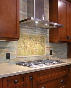 Oak tree mural composed of three large hand-cast, carved, and glazed tiles by Pasadena Craftsman Tile.
