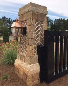 Custom aluminum gate and stone column with herringbone brick and copper lantern Brick Columns Driveway, Stone Driveway, Brick Fence, Front Yard Fence, Farm Entrance, Driveway Entrance, Entrance Ideas, Gate Lights, Column Lights