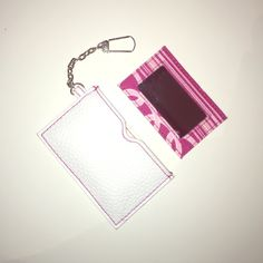 Clinique cardholder/mirror Cute, convenient to have in your purse, can put cards, contains stylish mirror. Clinique Bags Cosmetic Bags & Cases