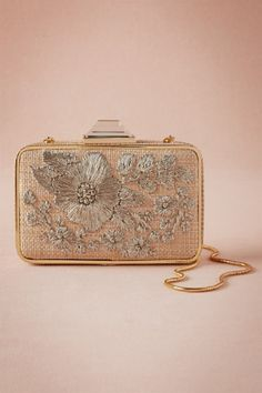 An embroidered box clutch that would suit Lady Mary on her wedding day. | Downton Abbey, as seen on Masterpiece PBS