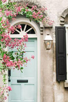 pale blue door, gas light, black shutter, pink crepe myrtle