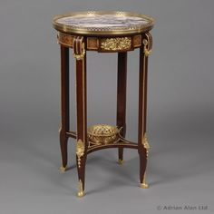 An Elegant and Unusual Mahogany & Parquetry Inlaid Gueridon