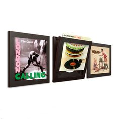 Framed records on the wall? You're an arse. Framed records on the wall you can still get down and play? Brilliant.