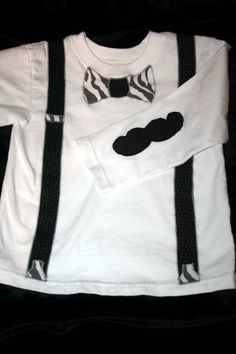 Bowtie and suspenders with mustache sleeve. Too funny!