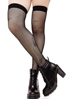 Everyday Slay Fishnet Thigh Highs fer when yer feelin' leggy, bb. Stunt on 'em in these fishnet thigh highs that feature a black stretchy nylon construction that hits yer legs above the knee.