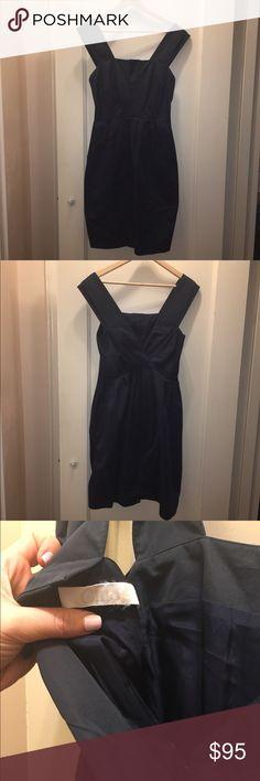 Navy blue Chloe dress. Navy blue Lined Chloe dress.  V-back with two large front pockets. Pleated skirt. Chloe Dresses Midi
