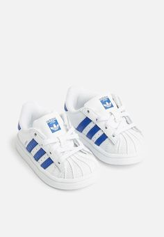 A style icon is remade for younger feet in these adidas Originals Superstar shoes. The junior shoes have all the classic details, including the smooth leather upper, rubber shell toe and gum rubber outsole. Superstars Shoes, Blue Adidas, Infants, Smooth Leather, Adidas Originals, Adidas Sneakers, Kids, Style, Fashion