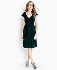 One amazing dress. Slip it on and everything feels easier; that's the power of instantly looking great. Inspired by retro styling, it's utterly modern with a double V-neck bodice and full drapey skirt plus stylized pockets that cross the side seams.