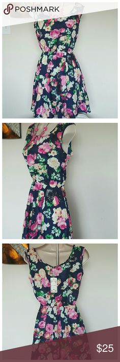 Sleeveless Floral Print Pleated Dress NWT Fashion Sleeveless Chiffon Floral Print Pleated Dress  New with tags. Sleeveless o-neck, floral print, lightly pleated dress. Navy base color with mix of pink, white, cream and green. Chiffon blend, fairly thin material. Size medium. 34? chest, 32? length, 22-33? waist (relaxed to expanded, elastic waistband) Dresses
