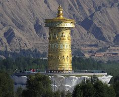 A very large prayer wheel along the shores of Yellow River, Tibet (by reurinkjan).