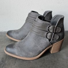"""A duo of buckled straps adorn the side cutouts of a burnished bootie, while an almond toe and stacked heel further the Western appeal. - 1 /2"""" heel (size 8.5). - 4 1/4"""" boot shaft. - Adjustable strap"""