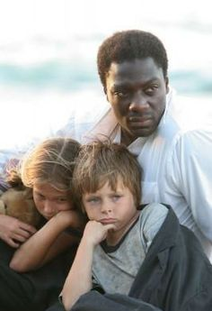 """2.07 """"The Other 48 Days"""" – Publicity still. Mr. Eko was awesome. Here he is looking after the kids, Zack and Emma, on the day of the crash. (I wonder if this is a deleted scene, or if these three just posed for this picture. Because there's nothing remotely like it in the episode.)"""