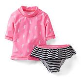 Protect her from sand and sun in this short-sleeve UPF 50  seahorse rash guard set. Ruffled bikini bottoms make it oh-so girly, too!