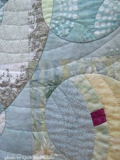 "Music of the Spheres, 48 x 24"", by Aileyn Renli Ecob. 2015 DVQ show. Closeup photo by Quilt Inspiration showing hand quilting."
