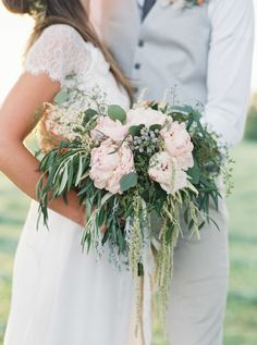 Reminds us of Spanish Moss: http://www.stylemepretty.com/vault/search/images/Flowers
