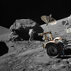 (13 December 1972) --- Scientist-astronaut Harrison H. Schmitt is photographed working beside a huge boulder at Station 6 (base of North Massif) during the third Apollo 17 Extravehicular Activity (EVA-3) at the Taurus-Littrow landing site. The front portion of the Lunar Roving Vehicle (LRV) is visible on the left. This picture was taken by astronaut Eugene A. Cernan, Apollo 17 commander.