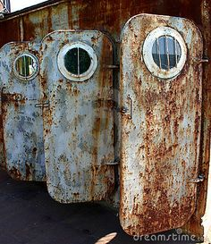 http://thumbs.dreamstime.com/x/old-rusted-doors-portholes-9413094.jpg
