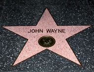 John Wayne's star Is located at 1541 Vine Street-Star on the Hollywood Walk of Fame / The Walk of Fame comprises more than 2,500 five-pointed terrazzo and brass stars embedded in the sidewalks along 15 blocks of Hollywood Boulevard and three blocks of Vine Street in Hollywood, California.  Wikipedia