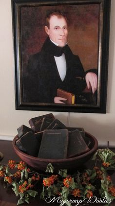 Ancestor portrait, wooden bowl and old leather bound books....ahhhh