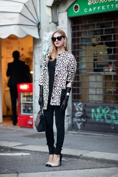 Chiara wears long leather gloves, animal print , black shades and red lips .Retro glamour! Streetstyle