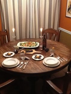 This is a photo of the same table, about a year before we refinished it.  It was overdue.