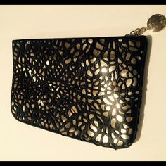 Ivanka Trump Clutch Black leather and gold clutch!  Leather is laser cut! Has zippered closure with a zipper compartment inside plus 8 credit card / ID slot! 9 X 6 NWOT (CB1) Ivanka Trump Bags Clutches & Wristlets