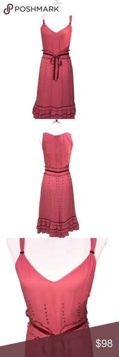 """Anthro Lithe Crepe Silk and Velvet Vintage Style Anthropologie Lithe, vintage style maxi dress. Rose silk crepe with dark pink accents flows over a silky lining. Velvet trim shoulder straps, dark pink dotted embroidery on waistline and skirting, ruffled waistline with velvet tie ribbon, layered ruffled hemline with velvet trim. Small pearl like beading lines the ruffles throughout. Appx measurements laid flat: bust 18"""", waist 14.5"""", hips 19"""", shoulder to hem 42"""". Zips in back. Dress is in…"""
