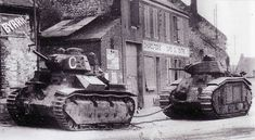French tanks-the lead vehicle is towing the trail vehicle. I'm not very good with French tanks, but it looks like a Somua towing a Char B. If I'm wrong, someone please tell me.