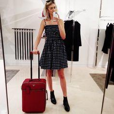 Prada diamond-print smocked dress, $1,345Barneys New York, NYC, 212.826.8900Prada pull-on ankle boots, $890barneys.comPrada rolling suitcase, price upon requestBarneys New York, NYC, 212.826.8900