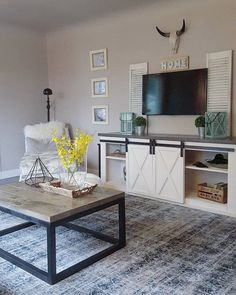 | Farmhouse | Industrial | Country | Living Room | DIY | Ana White | Nikki Grandy | Sliding Barn Door Console | Industrial Coffee Table | Antlers | Chic | Rustic | #anawhite